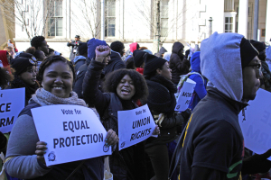 NCCU social work senior Shakera Obrey and english senior Rebekah Barber march through downtown Raleigh as a part of the 10th Annual HKonJ People's Assembly.