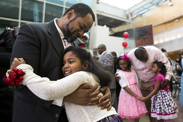 Ernest Johnson dances with his daughter Grace, 8, during a father-daughter dance at Little Black Pearl in Chicago on Saturday, Feb. 7, 2015. (Andrew A. Nelles/Chicago Tribune/TNS)