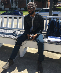 Alumnus Edward Harris, seated outside VSOP hair salon and coffee shop, says he feels a sense of responsibility to inspire students to reach their potential. Photo by Autavius Smith / Campus Echo staff photographer
