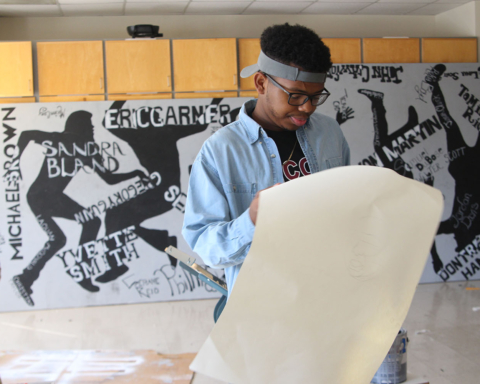 Art student Devin Davis finishing up the last touches on a Saturday morning. Photo by Tia Mitchell/Echo Co-Editor-in-Chief