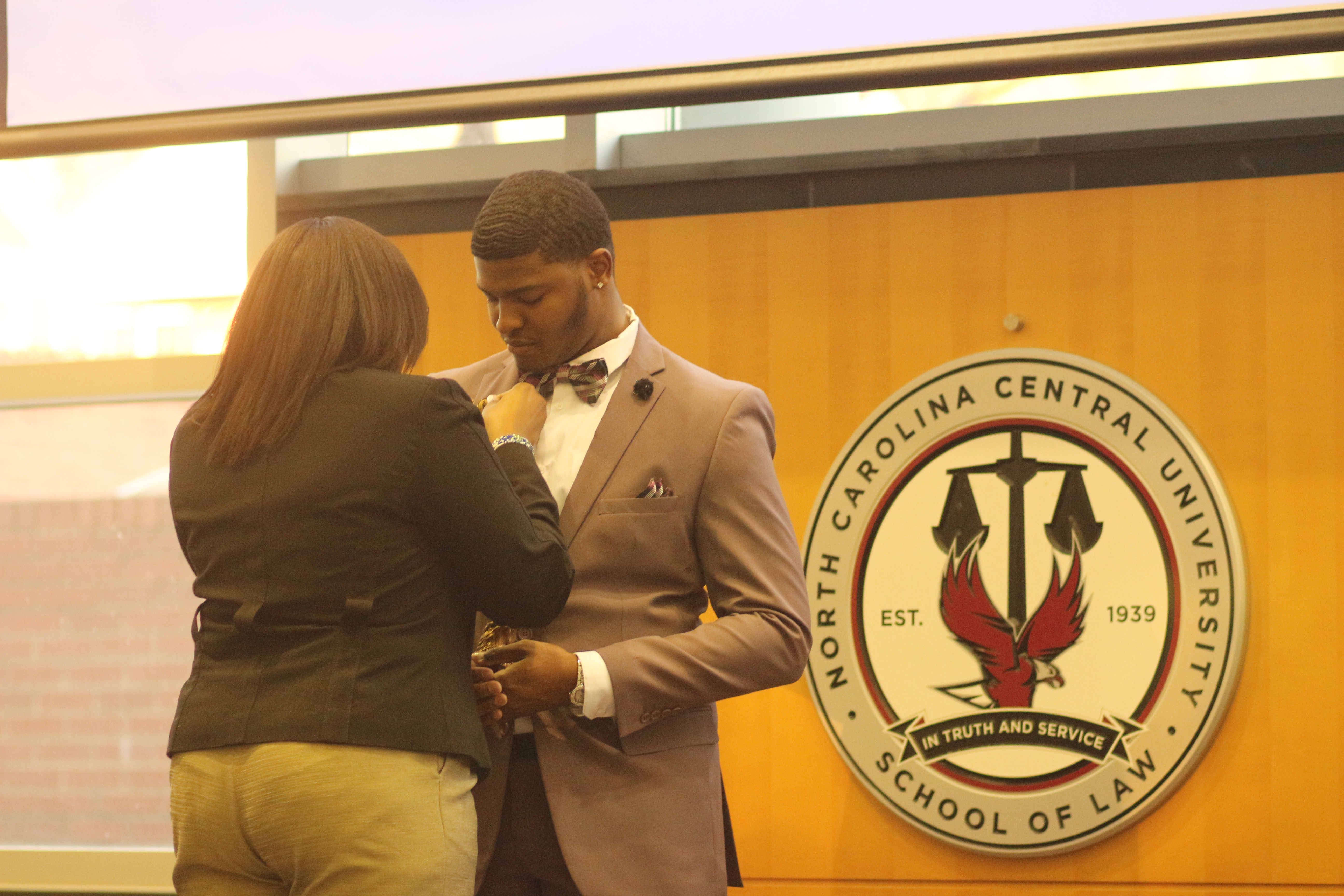 da4b9d80d 2019-20 SGA student body president-elect Brandon Hedgebeth gets pinned at  the Elections Gala in the NCCU School of Law's Great Hall on March 28, 2019.